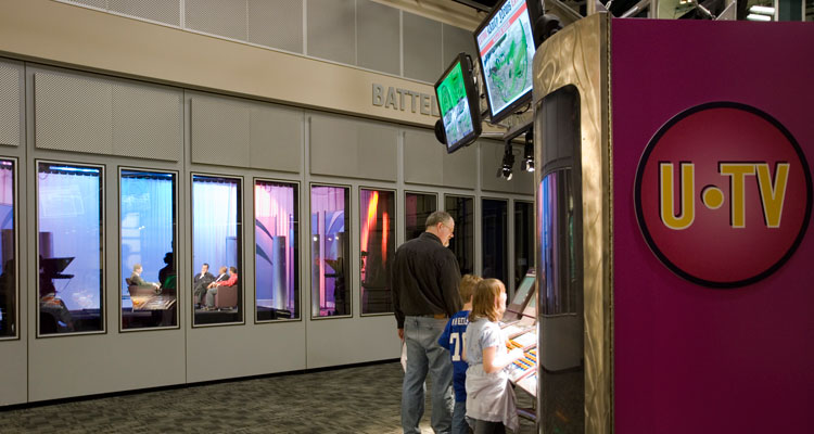 two children and their father look at an exhibit in WOSU Public Media's production and studio space at COSI