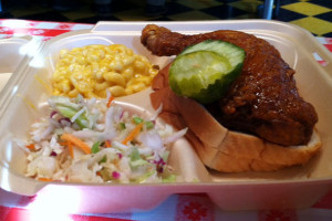 "Hot Chicken Takeover's ""hot"" dark (thigh and leg) with Ma's mac and a vinegar slaw. Photo Steve Stover."