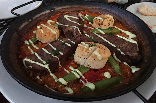 Barcelona's paella with braised beef short ribs and scallops. Photo: Steve Stover