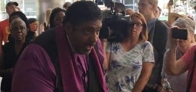 Traci Blackmon, acting executive minister of the United Church of Christ's Justice and Witness Ministries in Cleveland leveland, tried to present a petition to the DNC office in Philadelphia. KAREN KASLER