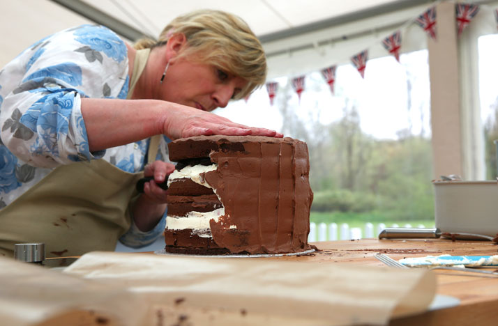 Sandy decorating her cake on season three of the Great British Baking Show. Photo: Love Productions