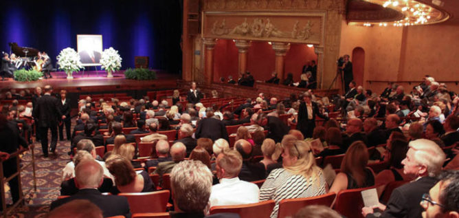 Nearly 400 people came to the Southern Theater to honor the life of John F. Wolfe.
