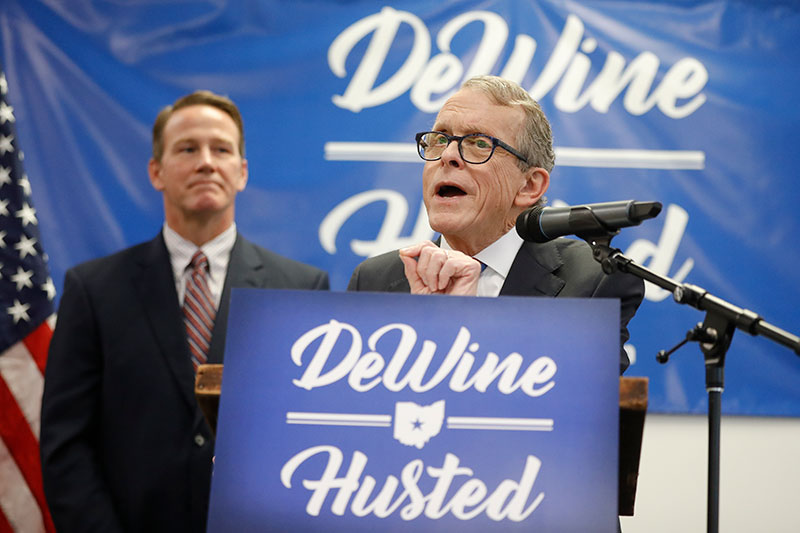 Ohio Attorney General Mike DeWine, right, speaks alongside Ohio Secretary of State Jon Husted, left, during a news conference at the University of Dayton to announce their decision to share the ticket in their bid for the Ohio governor.