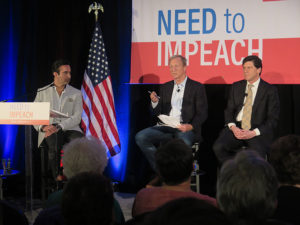 "Tom Steyer, center, talks to attendees at his ""Need to Impeach"" town hall in Columbus. KAREN KASLER / OHIO PUBLIC RADIO"