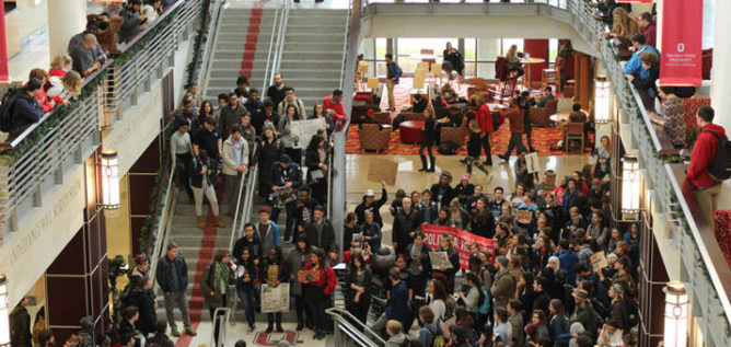 Hundreds of Ohio State students walked out of classes and gathered in the student union on Friday to protest the inauguration of President Donald Trump. ESTHER HONIG