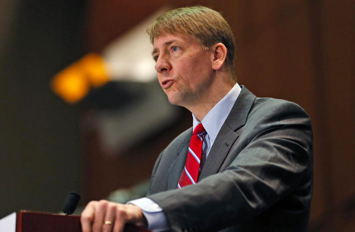 Richard Cordray, director of the CFPB, speaks during a panel discussion in 2015. STEVE HELBER / ASSOCIATED PRESS
