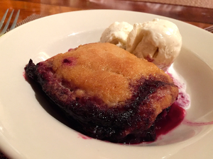 Mixed berry cobbler with vanilla ice cream at The Inn at Cedar Falls.