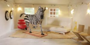 Zebras in a dollhouse by Charlotte Belland