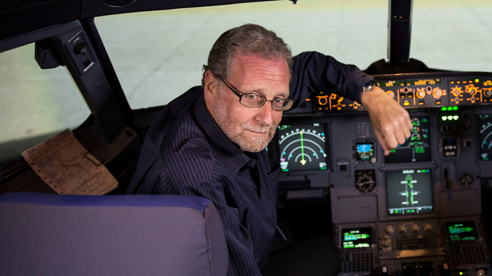 Peter Greenberg trains in the Airbus 320 simulator at Etihad Airways Headquarters in Abu Dhabi during filming of The Travel Detective.""