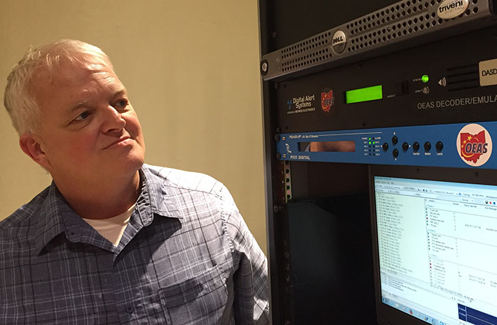WOSU TV Chief Engineer Tim Kelly checks the OEAS equipment during system testing.