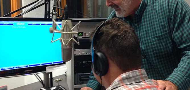 Classical 101 host Christopher Purdy (right) provides coaching in a recording studio for Braxton, one of three young adults on the autism spectrum that recently completed an internship at WOSU.