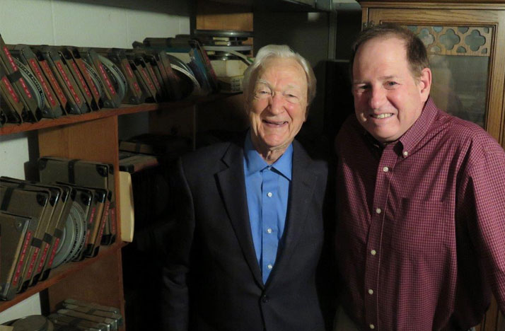 John Schmidt with Tom Rieland, WOSU General Manager in John's basement film and audio archive.