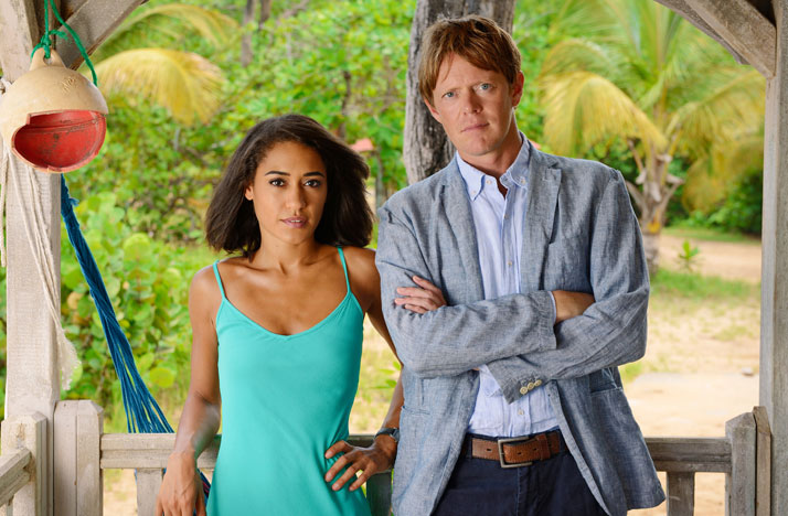 Florence Cassell (Josephine Jobert) and Humphrey (Kris Marshall) in the fifth season of Death in Paradise. Photo: Red Planet Productions