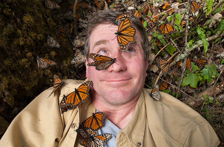 Joel Sartore takes a selfie with Monarch butterflies in the Sierra Chincua monarch sanctuary as a part of Rare: Creatures of the Photo Arc. Photo: Courtesy of © 2016 Joel Sartore Photography Inc.