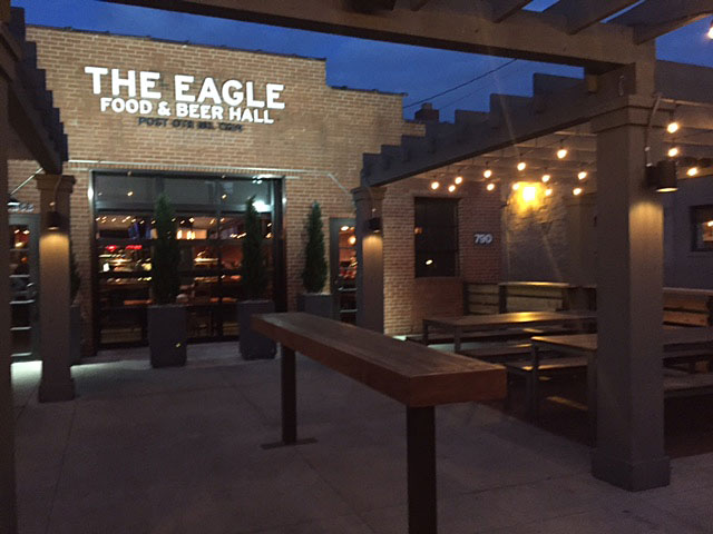 The Eagle Food & Beer Hall features a patio with views of High Street.