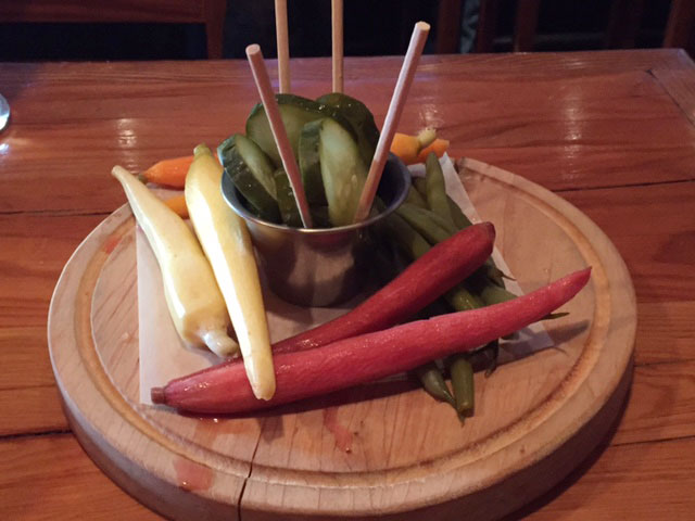 The Eagle's snack selection includes the house pickled country vegetables, including carrots, green beans, and pickles. Photo: Steve Stover