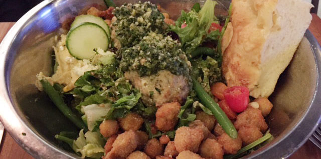 The Kitchen Sink Salad at Palle by Moretti features beef meatballs, greens, veggies, crispy garbanzo beans, hummus and balsamic vinaigrette. Photo: Steve Stover