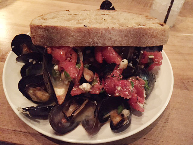 The mussels with white-wine broth, tomato and feta at Watershed Bar & Kitchen. Photo: Steve Stover