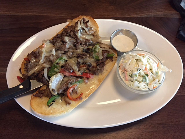 The Philly cheesesteak at Cap City Diner Dublin features horseradish sauce.