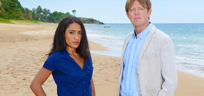 Josephine Jobert as DS Florence Casse and Kris Marshall as DI Humphrey Goodman in Death in Paradise Season 6.