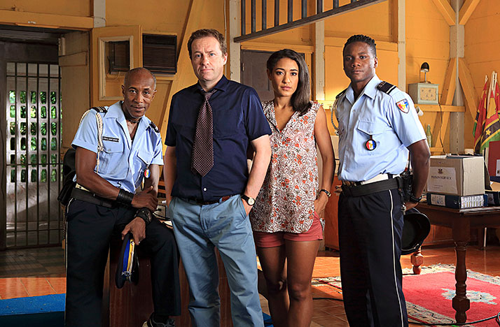 Ardal O'Hanlon (second from the left) joins the cast of Death in Paradise as D.I. Jack Mooney along with Danny John-Jules as Dwayne Myers (left), Josephine Jobert as DS Florence Casse (second from right) and Tobi Bakare as JP Hooper (right).