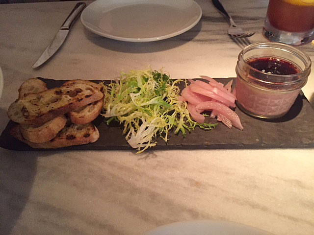The foie gras mousse served with house pickles, port gelee and a grilled baguette at The Keep Bar at the LeVeque Tower.
