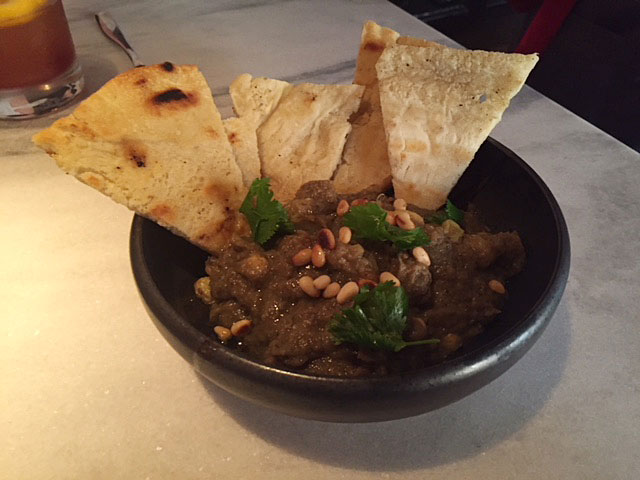 The melted eggplant with golden raisins, pine nuts and grilled flatbread at The Keep bar at LeVeque Tower. Photo: Rich Terapak.
