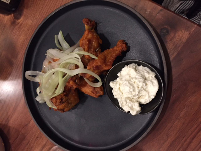 Confit chicken wings with smoky blue cheese foam at Veritas. Photo: Steve Stover