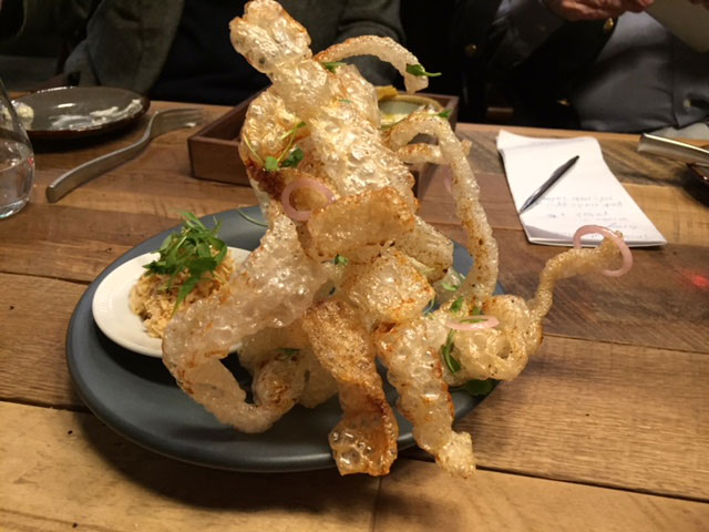 The special-fired pork rinds with a crab salad at Veritas.