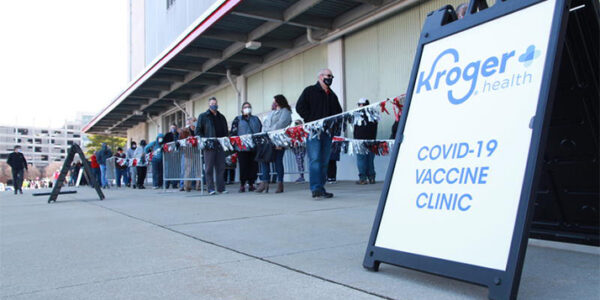 People line up at St. John Arena at Ohio State for a mass vaccination clinic on March 19, 2021. DARRIN MCDONALD / WOSU
