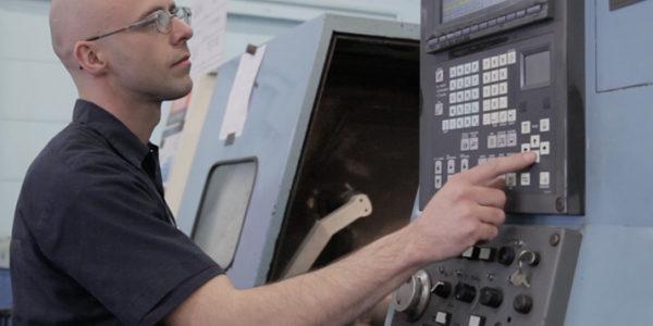 CNC Die Shop Machinist working with a machine