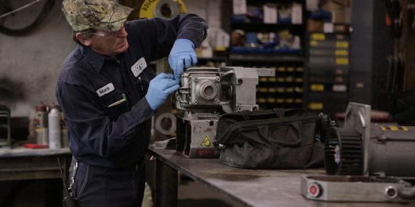 Multi-craft Maintenance Technician working on a machine part
