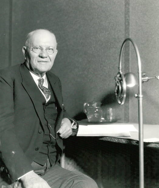 Ohio State President William Oxley Thompson poses in the WEAO radio studios in 1929.