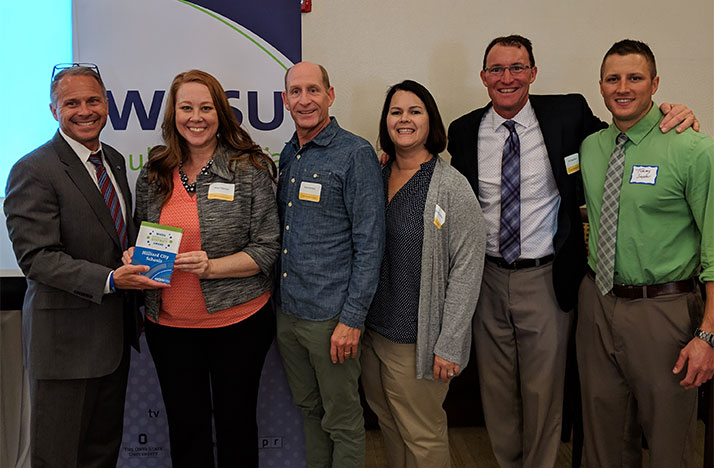Staff members of the Hilliard school district accept the 2019 Distinguished District Award given by WOSU Classroom as a part of the Excellence in Education Awards.
