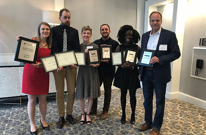 Members of WOSU's 89.7 NPR News team at the Ohio AP Media Editors awards banquet on May 4, 2019 with their awards. From left, Clare Roth, Nick Evans, Paige Pfleger, Gabe Rosenberg, Adora Namigadde and Mike Thompson.