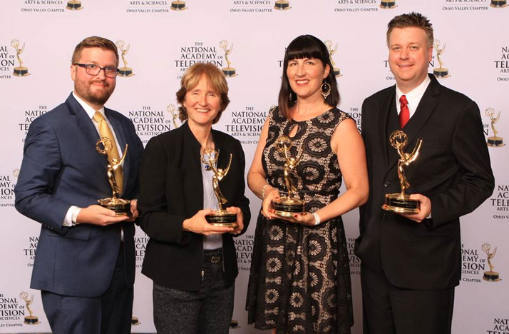 WOSU's Ryan Hitchcock (from left to right), Mary Rathke, , Diana Bergemann and Ben Bays accept  Ohio Valley Regional EMMY Awards for work on Columbus Neighborhoods.