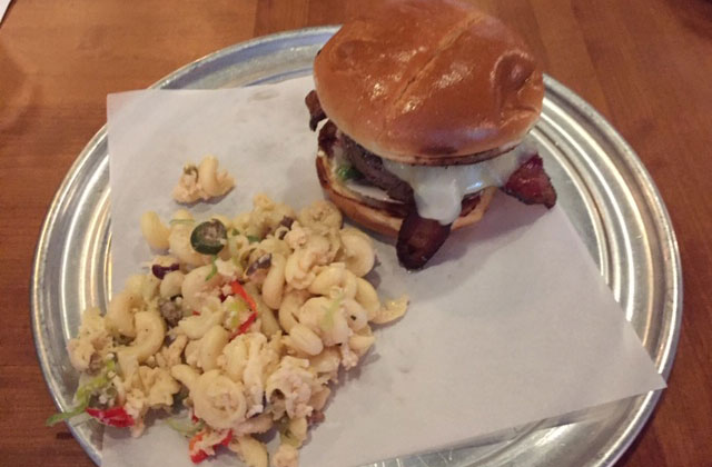 The Butcher Burger at The Old Spot is served with house house pasta salad.