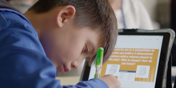 A Hilliard schools student completes classroom work with an iPad. COLUMBUS NEIGHBORHOODS / WOSU