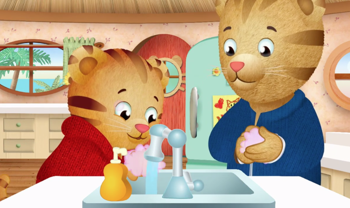 Daniel Tiger washing his paws with Daddy Tiger