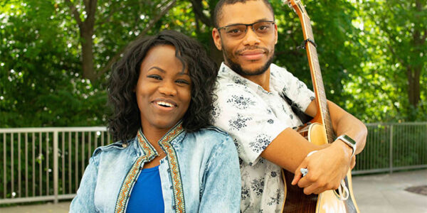 Starlit Ways members Rose Nkechi Onyeneho, left, and Chris Glover, right, holding a guitar