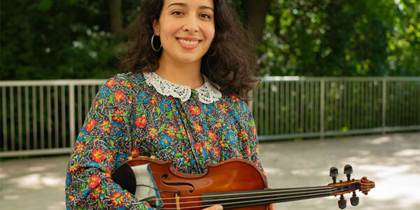 Mercedes Aviles holding a violin