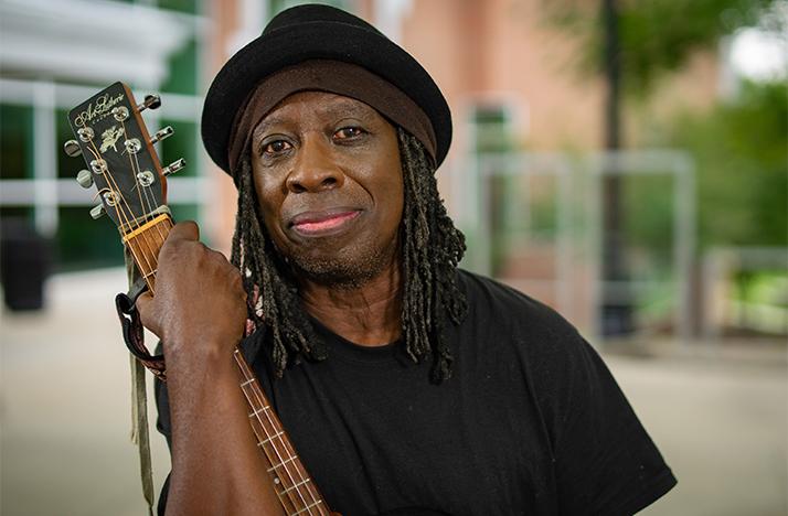 Willie Phoenix holding a guitar