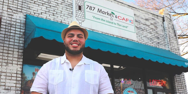 Harry Quiñones in front of the 787 Market & Café in old Brooklyn Ohio